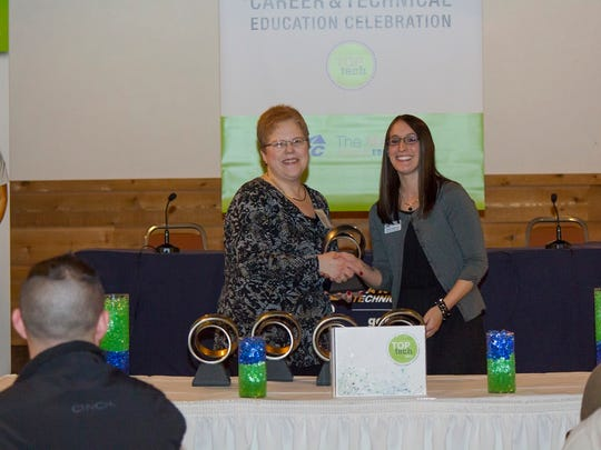 Two Rivers High School teacher Lisa Klein accepts her Top Tech Award from Lakeshore Technical College at the Lakeshore Culinary Institute in Sheboygan. At right is LTC High School Career Coach Ashley Armstrong.