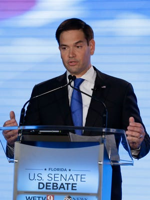 Sen. Marco Rubio, R-Fla., comments during a debate with Rep. Patrick Murphy, D-Fla., at the University of Central Florida, Monday, Oct. 17, 2016, in Orlando. (AP Photo/John Raoux)