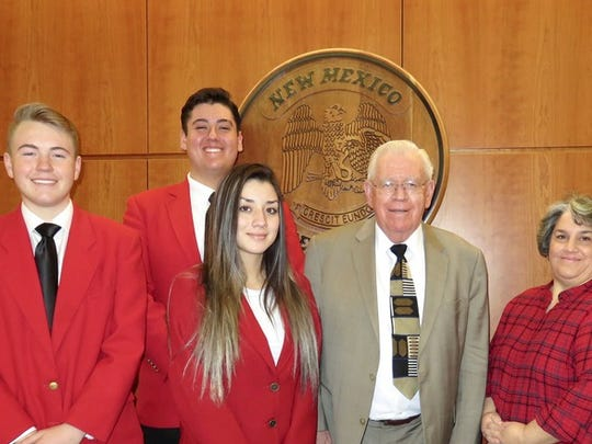 Deming High SkillsUSA students meet with Sen. John Arthus Smith (D-Dist.35) in Santa Fe. From left are Garret Borden, Joseph Sera, Shirley Galaviz, Sen.Smith and DHS culinary arts teacher Gen Wertz.