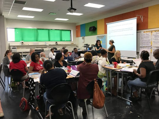 A group of teachers from Detroit Public Schools Community District attends training on the district's new curriculum at Martin Luther King Jr. High School in Detroit on July 17, 2018.