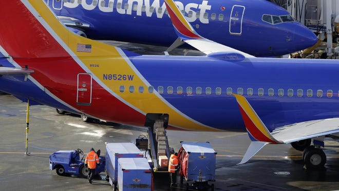 In this Feb. 5, 2019, file photo Southwest Airlines planes are loaded at Seattle-Tacoma International Airport in Seattle. Federal officials have told Southwest Airlines to fix the way it calculates the weight of luggage loaded on flights after finding frequent mistakes.