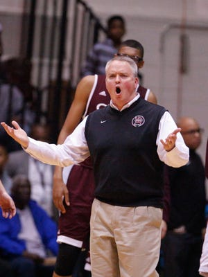 University of Detroit Jesuit coach Pat Donnelly disputes a call during the first quarter against Ypsilanti on March 22, 2016 at Calihan Hall in Detroit.
