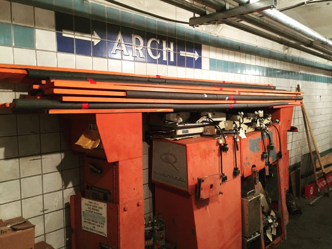 A sign points the way to Arch Street, while beneath
