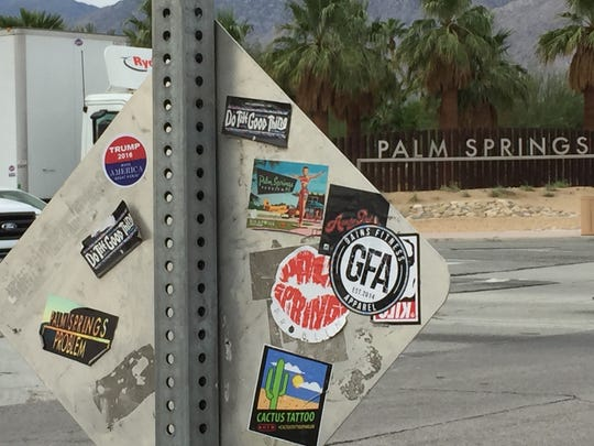 Trump sticker on upper right of sign at the intersection of Vista Chino and Gene Autry Trail in Palm Springs on Oct. 28, 2015.