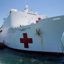 The hospital ship USNS Mercy sits at anchor upon its arrival off the coast of Da Nang, Vietnam, for Pacific Partnership 2015.