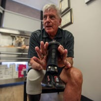 Patrick Tierney demonstrates his Kinnex waterproof microprocessor-controlled prosthetic ankle-foot outside the Hangar Clinic in Rancho Mirage on Friday, July 8, 2016.