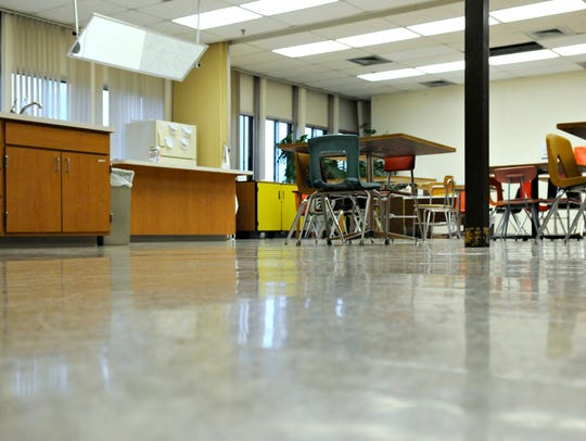 Rippling wood floors in a third floor class room of