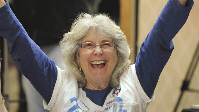 Suzanne Gates reacts to Obama's victory in 2012.