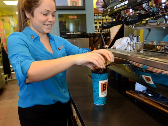 Co-owner Erica Brooks pours two cups of espresso into a coffee Monday, Jan. 25, at the new Biggby Coffee location in Fort Gratiot.