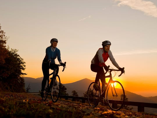 Bicyclists ride along the Blue Ridge Parkway near Roanoke, Va.
