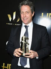 Hugh Grant, recipient of the Hollywood Supporting Actor