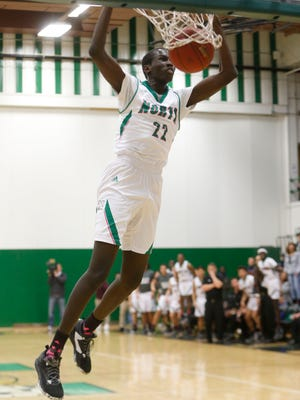 North senior Jal Bijiek (22) dunks the ball against Hoover Friday, Jan. 6, 2017 during their game at North High School in Des Moines