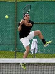 Nicky Wong, the 2012 champ, hits a return in his men's singles finale with Mason Dragos on Monday night at Lakewood Racquet Club.