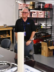 Ronald Jones, co-founder and chief technologist of Rocket Crafters, stands by a cylinder of 3-D printed hybrid rocket fuel now being tested at an industrial facility in Cocoa. Rocket Crafters is designing the Intrepid rocket for launches of small satellites.