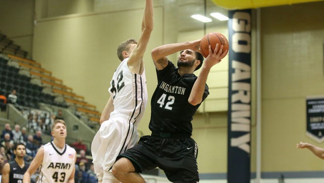 Binghamton University forward Willie Rodriguez drives to the basket during a game against Army at West Point in November 2014. Rodriguez had 20 points and 10 rebounds in the Bearcats' 80-54 loss.
