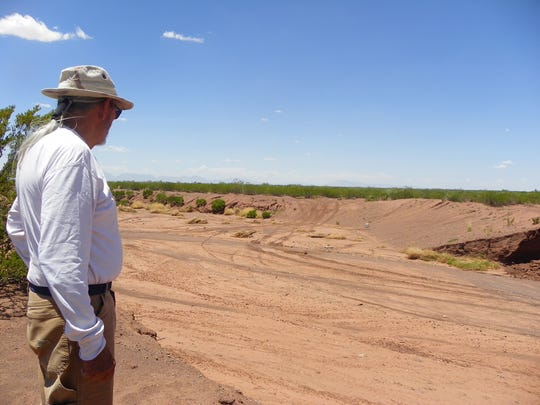 Franklin Herrera looks at an arroyo that was not on his property.