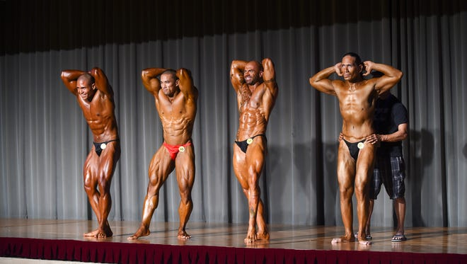Michael Duay (8), Dan Munoz (10), Derek Cutting (18) and Jason Cruz (11) compete in the National Heavyweight Division during the Michelob Ultra Guam National Fitness Championships and International Invitational at Leo Palace Resort on Sept. 26. Munoz was named the Guam men's national champion.