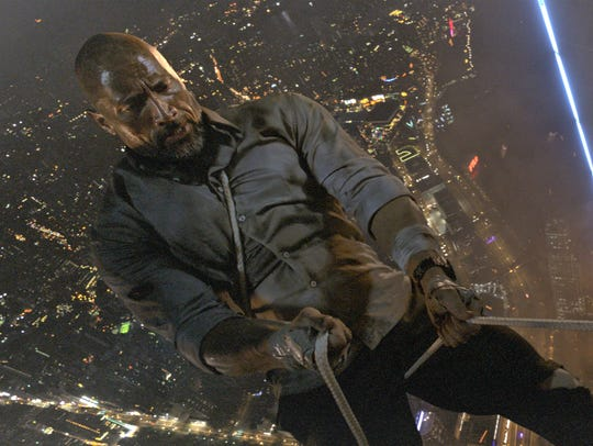 "Will (Dwayne Johnson) gets high in ""Skyscraper."""