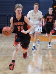 Powell's Caleb Tripp (32) drives down the court during