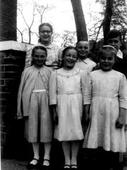 Mennonite children pose in front of the old Knoxville