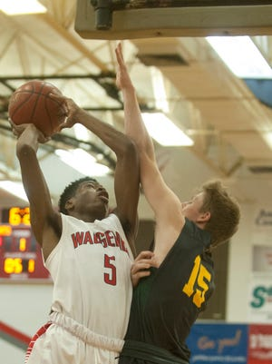 Waggener guard Kevion Hudson drives to the basket as St. X guard-forward Clay Borders defends.Dec. 08, 2017