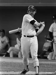 Yankees catcher Thurman Munson swings a bat and doughnut while warming up on deck before the opening game of the exhibition season against the Baltimore Orioles at Ft. Lauderdale's Yankees Stadium, March 1977. (AP Photo/Kathy Willens)