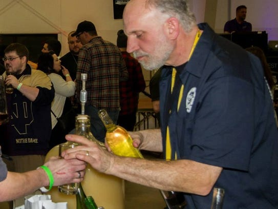 Vendor serves drink to Brewfest attendee.