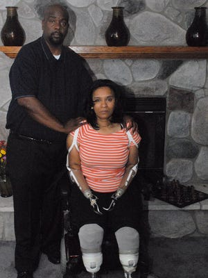 Ascaris Mayo, shown with her husband Antonio, lost her limbs after medical personnel atColumbia St. Mary's Hospital failed to diagnose an infection or offer her antibiotics to treat the condition. She received $750,000 in noneconomic damages, such as pain and suffering.