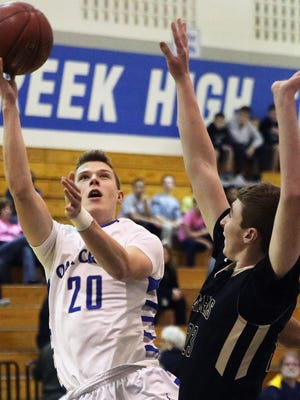 Oak Creek's Drew Yetka shoots over Franklin's Zak Klug on Nov. 13. Yetka is averaging 20.5 points a game this year, up from 9.8 last year.