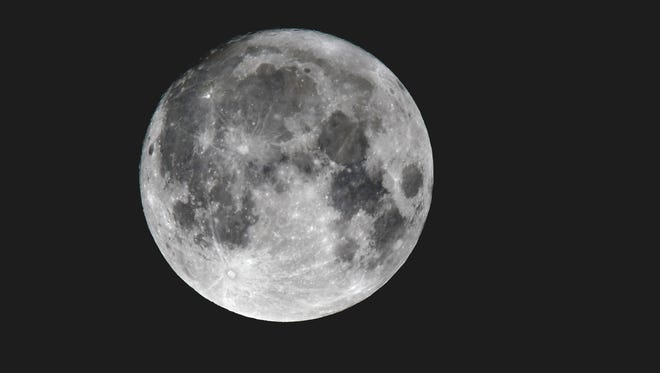 The supermoon hangs in the sky over Metro Detroit.