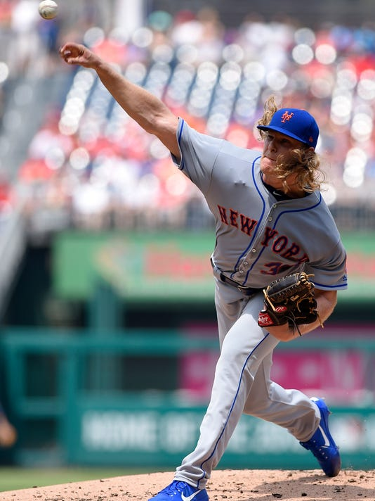 New York Mets starting pitcher Noah Syndergaard (34) delivers a pitch during the first inning of a baseball game against the Washington Nationals, Sunday, April 30, 2017, in Washington. (AP Photo/Nick Wass)