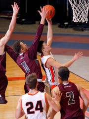 Charlotte's Justin Bates, right, goes up for a layup