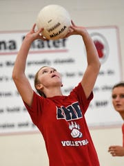 Emylie Green sets a ball for a teammate to hit during