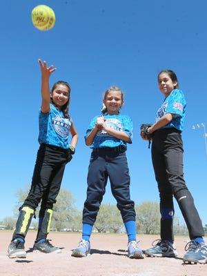 Kennedy Williams, left, Julia Saucedo and Amanda Lujan of the Lil' Tarheels will be taking part in the Pitch Hit & Run competition on Saturday.