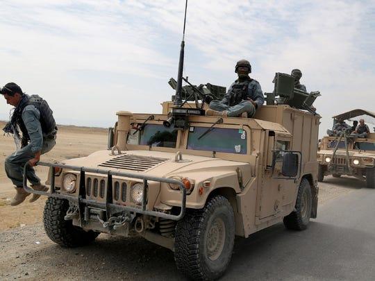An Afghan policeman in action in Ghazni, Afghanistan,