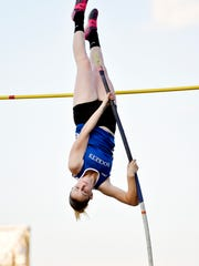 Spring Grove's Nathalie Elliott competes in the pole vault during the YAIAA Track and Field Championships Friday, May 13, 2015, at Dallastown.