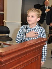 Nine-year-old Nicky Snow leads the Village of Estero Council in the Pledge of Allegiance Wednesday morning.