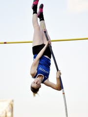 Spring Grove's Nathalie Elliott competes in the pole vault during the YAIAA Track and Field Championships last season.
