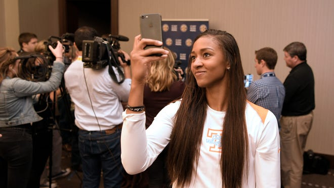 Tennessee player Jaime Nared takes a selfie while her coach, Holly Warlick, talks to the media during the 2017-18 SEC Women's Basketball Media Day at the Omni Hotel in Nashville on Thursday, Oct. 19, 2017.