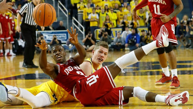 Indiana forward Justin Smith (3) passes the ball after a floor scramble against Michigan forward Moritz Wagner (13) in the first half of an NCAA basketball game in Ann Arbor, Mich., Saturday, Dec. 2, 2017.