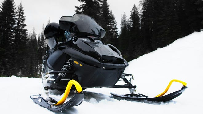 Two lost snowmobiliers were rescued Wednesday after getting stuck in deep snow in the Little Belt Mountains