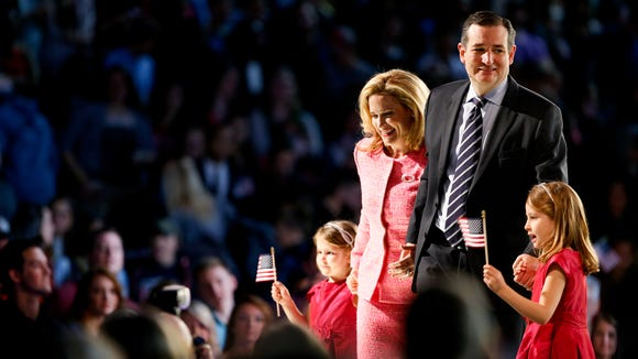 Sen. Ted Cruz, R-Texas, his wife Heidi, and their two daughters Catherine, 4, left, and Caroline, 6, right, gather on stage after he announced his campaign for president, Monday, March 23, 2015, at Liberty University in Lynchburg, Va.