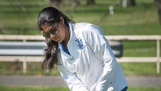 Mehr Sawant of Holmdel, putts at lat week's Monmouth County Tournament. On Monday she helped the Hornets win the Shore Conference Tournament.