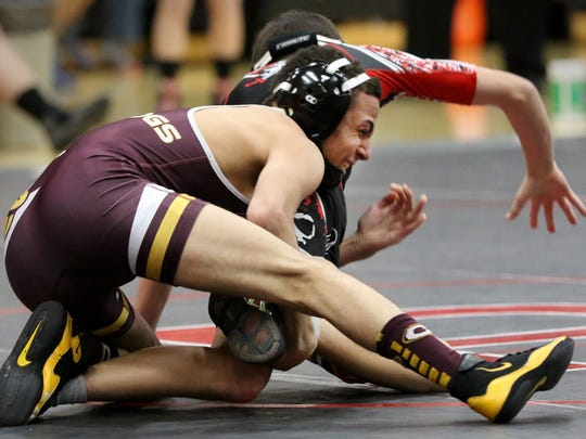 West Allis Central's Quentin Brown grapples with Pewaukee's