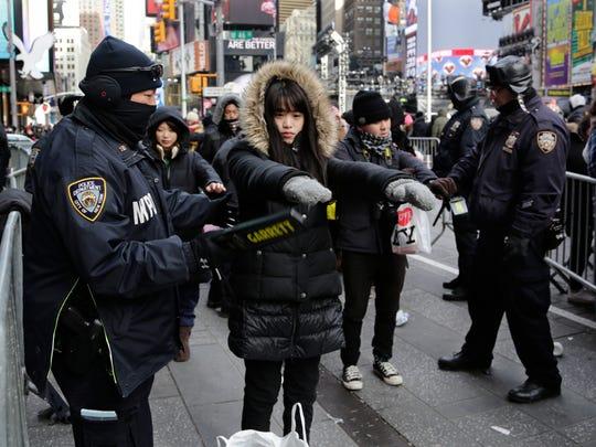 Spectators pass through security screening ahead of