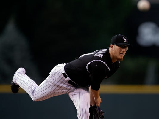 CORRECTS TO SATURDAY NOT FRIDAY - Colorado Rockies starting pitcher Jeff Hoffman delivers against the Chicago White Sox in the first inning of a baseball game Saturday, July 8, 2017, in Denver.(AP Photo/Joe Mahoney)