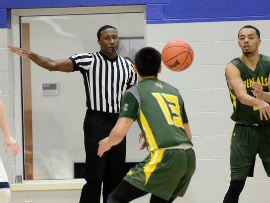 Brandon Parker referees the Maine-Fort Kent at Penn