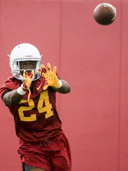 Iowa State's Johnnie Lang runs a drill in practice