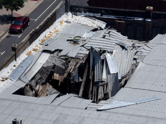 A historic downtown building whose future was uncertain after its roof collapsed now has a new owner.