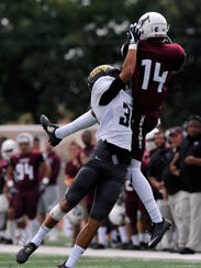 McMurry University wide receiver Justin Eaton catches
